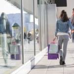 Female friends walking on sidewalk — Stock Photo #57274191