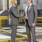 Architects shaking hands — Stock Photo #57276743