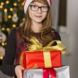 Girl holding stack of presents — Stock Photo #57277025