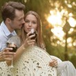 Young couple having red wine — Stock Photo #57278259