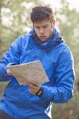 Hiker reading map — Stock Photo