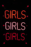 Girls written in neon lights — Stockfoto