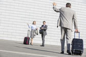 Businessman carrying luggage — Stock Photo