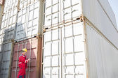 Worker inspecting cargo containers — Stockfoto
