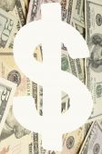Dollar sign over banknotes — Stock Photo