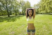 Woman stretching at park — Foto de Stock