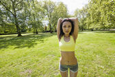 Woman stretching at park — Stock Photo