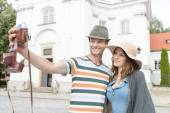 Couple taking self portrait outside St. Casimir Church — Stock Photo