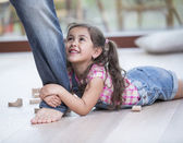 Girl being dragged by father — Stock Photo