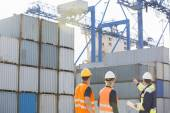 Workers inspecting cargo containers — Stock Photo