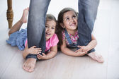 Father dragging girls — Stock Photo