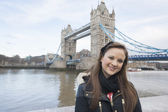 Woman standing in front of tower bridge — Stock Photo