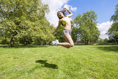 Woman jumping in park — Foto Stock