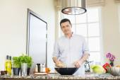 Confident man preparing food — Stock Photo