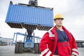 Worker standing in front of freight vehicle — Stock Photo