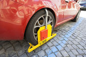 Red Car clamped — Stock Photo