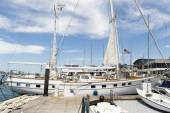 Yacht moored at dock — Stock Photo