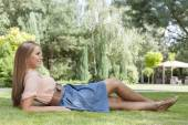 Woman reclining on grass — Stok fotoğraf