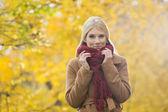 Woman holding muffler around neck — Stock Photo