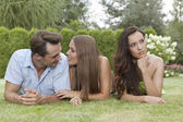 Young couple ignoring female friend — Stock Photo