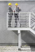 Architects communicating on stairway — Stock Photo