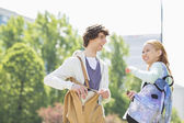 Smiling male and female students — Stock Photo
