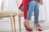 Woman trying on footwear — Stock Photo