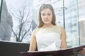 Businesswoman reading file — Stock Photo
