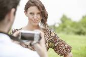 Woman being photographed by man — Stock Photo