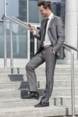 Businessman text messaging — Stock Photo