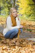 Young woman crouching on steps — Stock Photo