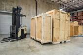 Forklift and wooden containers — Stock Photo
