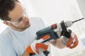 Man drilling in wall — Stok fotoğraf