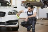 Engineer cleaning car — Stock Photo