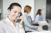 Businesswoman using landline telephone — Stock Photo