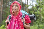 Backpacker in raincoat looking away — Stock Photo