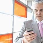 Businessman using smart phone — Stock Photo #57280037