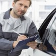 Mechanic holding clipboard — Stock Photo #57280699