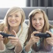 Sisters playing video games — Stock Photo #57281493