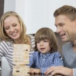 Parents and son playing with wooden blocks — Stock Photo #57283393