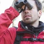 Backpacker using binoculars — Stock Photo #57283817
