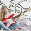 Girl playing guitar — Stock Photo #57284065