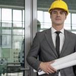Architect holding blueprints — Stock Photo #57284317