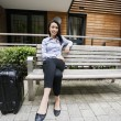 Businesswoman sitting on bench — Stock Photo #57284691