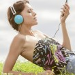 Woman listening to music — Stock Photo #57285449