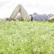 Man lying on grass — Stock Photo #57285869
