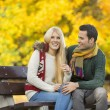 Couple sitting on park bench — Stock Photo #57286443