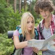 Hiking couple reading map together — Stock Photo #57286881