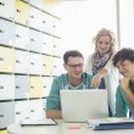 Businesspeople using laptop — Stock Photo #57287679