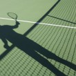 Shadow of man playing tennis — Stock Photo #57288445
